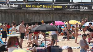 Sunseekers flocked to Bournemouth beach on Friday (Steve Parsons/PA)