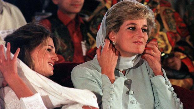 The Princess of Wales and Jemima Khan pull scarves over their heads during a reading from the Koran at the Shaukat Khanum Hospital in Lahore (John Giles/PA)