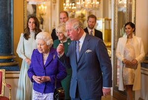 The Queen and the Prince of Wales, followed by the Duke and Duchess of Cambridge, the Duchess of Cornwall, and the Duke and Duchess of Sussex at a reception at Buckingham Palace (Dominic Lipinski/PA)