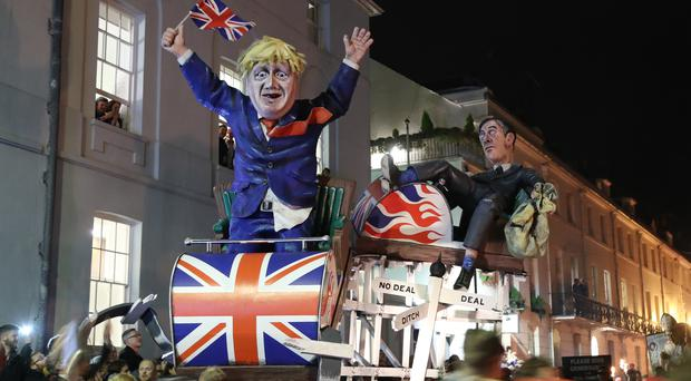 An effigy of Boris Johnson and Jacob Rees-Mogg during the parade through Lewes (Gareth Fuller/PA)