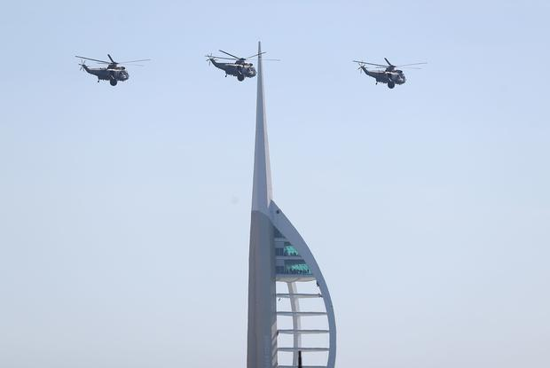 Three Royal Navy Sea King helicopters fly past the Spinnaker tower (Andrew Matthews/PA)