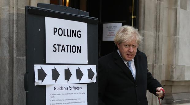 Prime Minister Boris Johnson leaves the polling station with his dog Dilyn after casting his vote in the 2019 General Election (Rick Findler/PA)