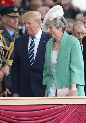 Mr Trump and Theresa May arrive for the event (PA)