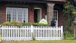 Surrey Police officers conduct house to house inquiris on the A25 Bletchingley Road, Godstone, near Reigate, after an 88-year-old man was found dead in a home (Steve Parsons/PA)