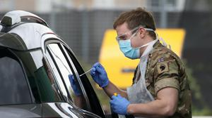 A soldier assists at a Covid-19 testing centre at Glasgow Airport (Andrew Milligan/PA)