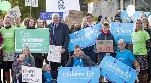 A rally outside the Scottish Parliament in Edinburgh in support of the Children (Equal Protection from Assault) (Scotland) Bill (Jane Barlow/PA)