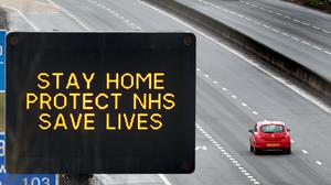 A motorway sign advising drivers to stay home, protect the NHS and save lives (Andrew Milligan/PA)
