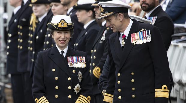 The Princess Royal and Rear Admiral John Weale join serving Royal Navy submariners, veterans, families and support workers gather at HM Naval Base Clyde, the home of the UK Submarine Service at Faslane in Argyll and Bute, to mark 50 years of the Continuous At Sea Deterrent (Jane Barlow/PA)