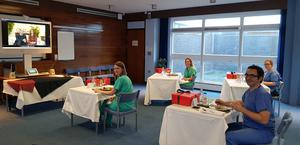 NHS staff enjoy their haggis as they watch William and Kate's video message. Kensington Palace / NHS Tayside