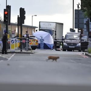 Police activity close to the scene where a man was murdered in John Wilson Street, Woolwich, south east London