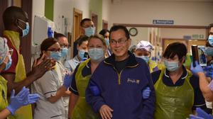 NHS nurse Felix Khor, 68, walks out of a ward at Southend Hospital after recovering from coronavirus (NHS Mid and South Essex NHS Foundation Trust/ PA)