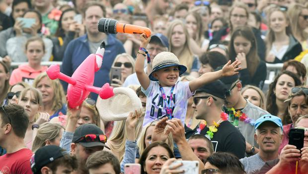 Crowds watch Rita Ora performing during the second day of BBC Radio 1's Biggest Weekend at Singleton Park in Swansea (Ben Birchall/PA)
