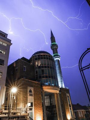 Here the sky is lit up over the Suleymaniye Mosque in Dalston, east London (Andrew Lanxon Hoyle/@Batteryhq/PA)
