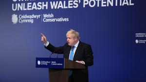 Prime Minister Boris Johnson addressing the Welsh Conservative Party Conference in the Llangollen Pavilion in North Wales (Peter Byrne/PA)