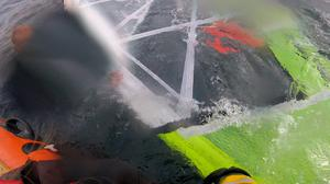 The windsurfer was rescued by lifeboat crew (RNLI/PA)