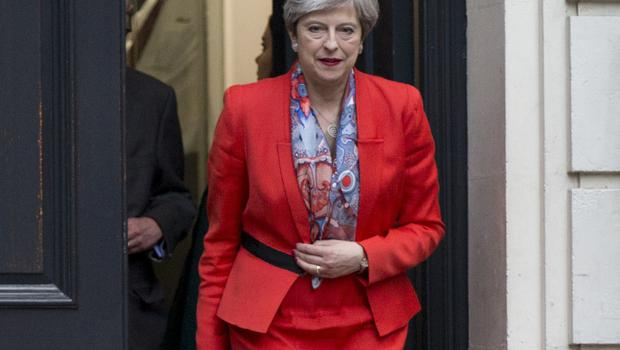 Theresa May leaves Conservative Party HQ in Westminster (Rick Findler/PA)