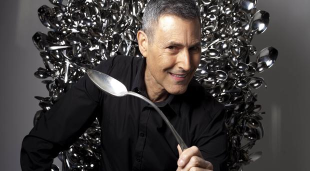 Uri Geller sits on a throne of spoons (David Parry/PA)