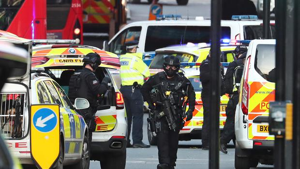 Armed police and emergency services at the scene (Gareth Fuller/PA)