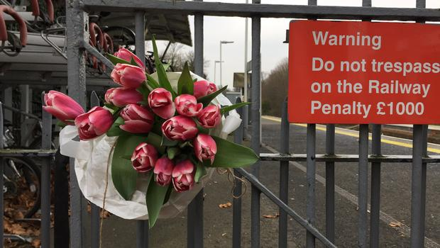 Flowers left at Horsley station near Guildford (Lizzie Roberts/PA)