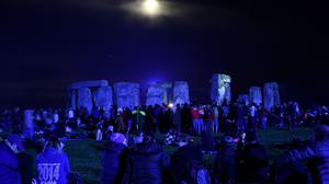 People gather at Stonehenge to see in the new dawn after this year's Summer Solstice
