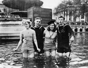 Joyce Digney and Cynthia Covello were famously photographed celebrating VE Day with two sailors in a fountain in Trafalgar Square (Imperial War Museum/PA)