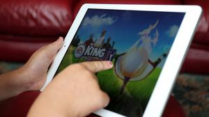 A child using an Apple iPad tablet.