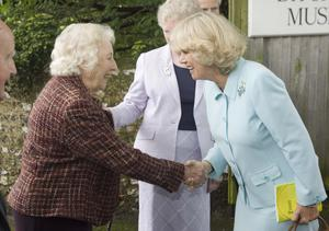 The Duchess of Cornwall shakes hands with Dame Vera Lynn during a visit in May 2006 to Ditchling Museum in Ditchling, East Sussex (Michael Dunlea/PA)