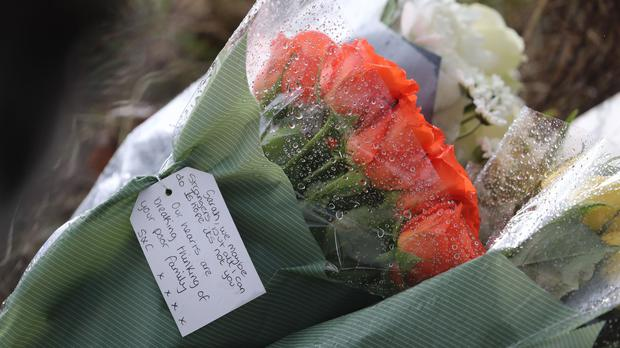 Flowers from members of the public left near Great Chart Golf and Leisure near Ashford in Kent following the discovery of human remains in the hunt for missing Sarah Everard (Gareth Fuller/PA)