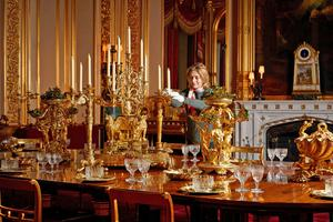 A Royal Collection Trust curator puts the finishing touches on the display of the silver-gilt Grand Service in the State Dining Room (Royal Collection/Her Majesty Queen Elizabeth II 2020/PA)