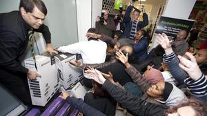 Shoppers at the Asda store in Wembley take advantage of its Black Friday offers in 2014.