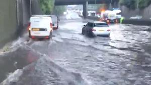 Flash flooding on the M25 near Redhill (@planetmyk/Mike Purvey/Twitter/PA)