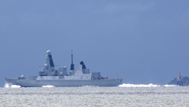 HMS Defender passes the Isle of Wight after leaving Portsmouth Harbour (Steve Parsons/PA)