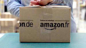 Amazon has given a pay rise to pickers and drivers (Chris Radburn/PA)
