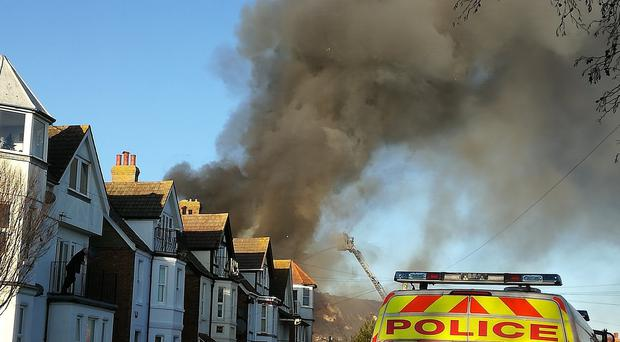 Large plumes of smoke could be seen coming from the house fire (Sam Millen/PA)