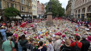 Tributes in St Ann's Square in Manchester following the Manchester Arena terror attack (Danny Lawson/PA)