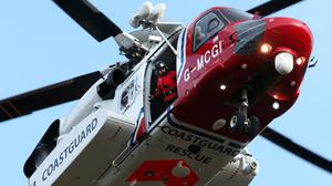The crew were rescued by coastguard helicopter (Andrew Milligan/PA)