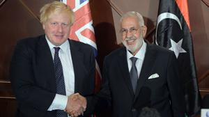Boris Johnson met Libyan foreign minister Mohamed Taha Siala during a visit to Tripoli in August 2017 (Ben Birchall/PA)