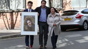 Nadim and Tanya Ednan-Laperouse with their son Alex holding a picture of Natasha Ednan-Laperouse (Jonathan Brady/PA)