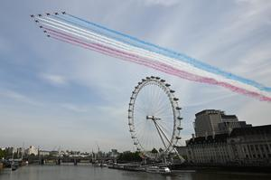 The Royal Air Force Red Arrows pass over the London Eye on the banks of the River Thames (Marc Ward/PA)