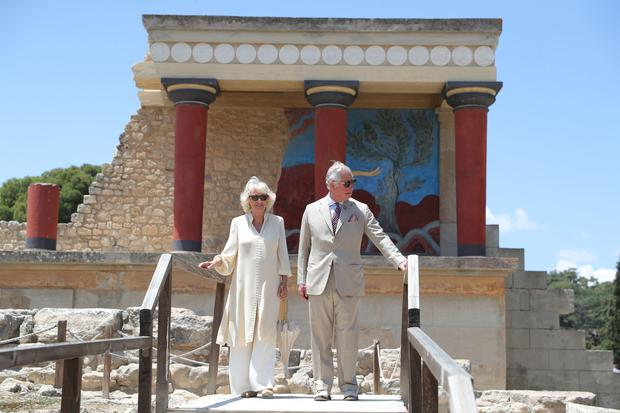 The Prince of Wales and the Duchess of Cornwall during a previous visit to the Knossos archaeological site in Crete (Andrew Matthews/PA)