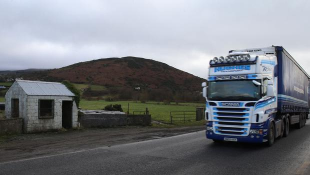 A truck passes a former customs post on the northern side of the Irish border in County Armagh (Niall Carson/PA)
