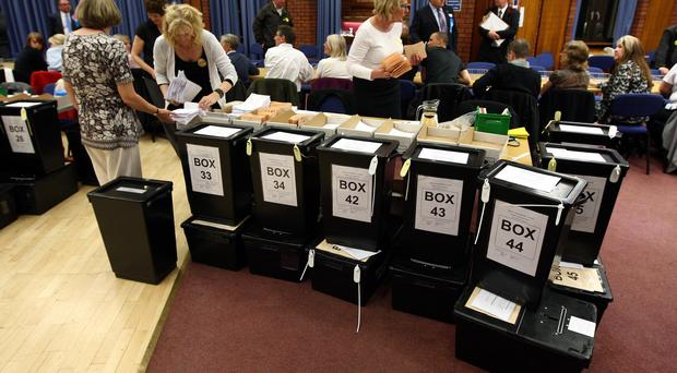 Ballot boxes waiting to be emptied and counted (David Jones/PA)