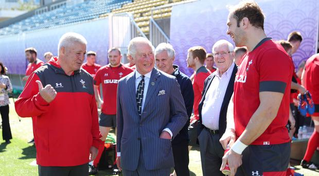 The Prince of Wales with Wales head coach Warren Gatland (left) and captain Alun Wyn Jones (right) (David Davies/PA)