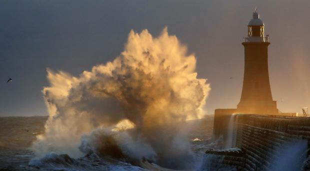Rough sea batters the pier at Tynemouth on the North East coast (Owen Humphreys/PA)