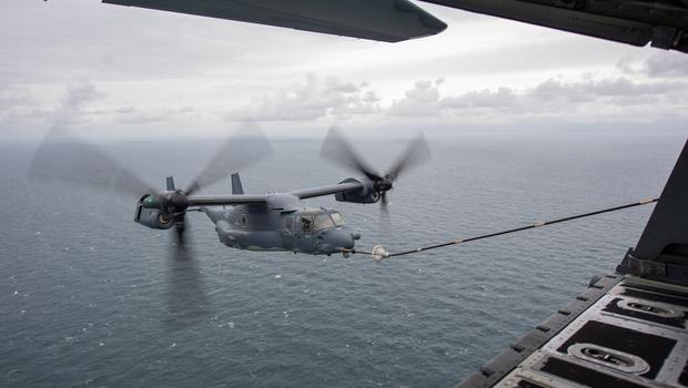 A United States Air Force (USAF) CV-22 Osprey, which can take off and land like a helicopter but has aeroplane-style wings, is refuelled during Operation Point Blank (Joe Giddens/ PA)