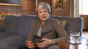 Theresa May defended her decision to hold cross-party talks with Labour in a video message filmed at her Chequers country retreat (Downing Street/PA)