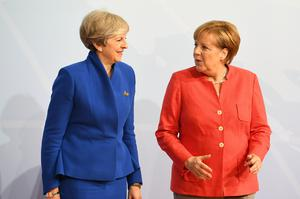 Theresa May will meet German Chancellor Angela Merkel on Tuesday (Stefan Rousseau/PA)