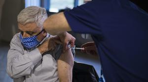 A patient receives the first of two injections with a dose of the Pfizer/BioNtech Covid-19 vaccine (Kirsty O'Connor/PA)