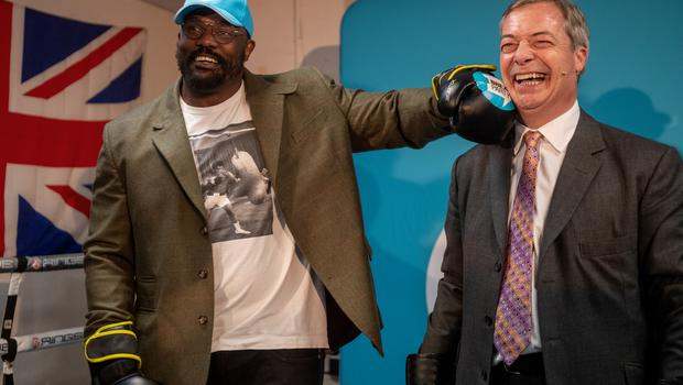 Boxer Dereck Chisora with Nigel Farage at the Gator ABC Boxing Club in Hainault, Ilford (Joe Giddens/PA)