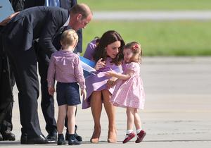 The Cambridges, George and two-year-old Charlotte, who was having a tantrum, at Hamburg Airport during the family's three day tour of Germany (Jane Barlow/PA)